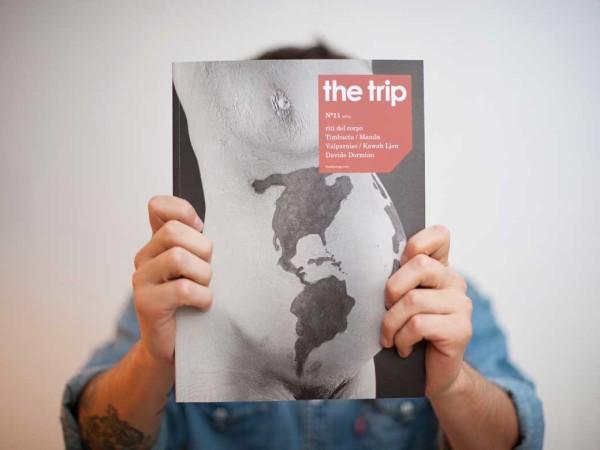 <span>The Trip</span><i>→</i>